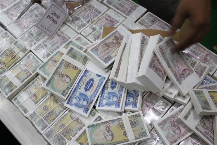 Mơ thấy tiền lẻ là tiền giả